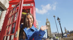 Happy Woman Waving At Red Phonebooth In London England Stock Footage
