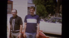 1968: two groups of people posing alternately at the camera  Stock Footage