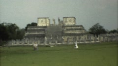 1973: people walking in front of towering and impressive ancient mayan ruins Stock Footage