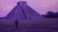 1973: visitors at ancient mexican pyramid on a cloudy day MEXICO Stock Footage