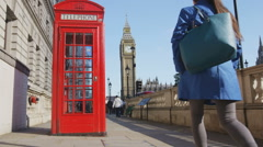 Young Urban Professional Woman By Telephone booth and Big Ben In London Stock Footage