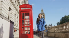 Young Urban Professional Business Woman By Telephone booth and Big Ben In London Stock Footage