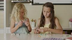 Medium panning shot of girls assembling models of molecules / Orem, Utah, United Arkistovideo