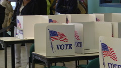 Tilt up from carrel to line of Ohio voters waiting to cast ballots. Stock Footage