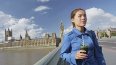 Woman Drinking Green Vegetable Smoothie On Westminster Bridge London Stock Footage