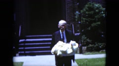 1951: grandad walking with the baby with mom and dad CLEVELAND, OHIO Stock Footage
