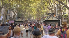 People walking down the La Rambla street Stock Footage