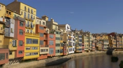 Colourful houses on the river Onyar in Girona, Spain Stock Footage