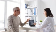 Senior man and doctor with tablet pc at hospital 66 Stock Footage