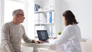 Senior man and doctor with tablet pc at hospital 67 Stock Footage