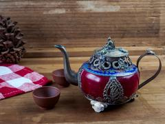 Vintage Chinese teapot made of old jade and Tibet silver with monkey lid Stock Photos