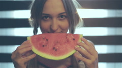 . Young woman is biting a delicious juicy red watermelon. Stock Footage
