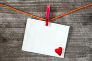Message and red heart on the clothesline Stock Photos