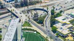 Timelapse Overview of Traffic Jam at Freeway Ramp in Los Angeles -Tilt Up- Stock Footage