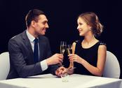 Couple with glasses of champagne at restaurant Stock Photos