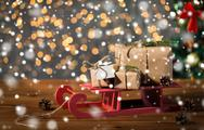 Close up of christmas gift boxes on wooden sleigh Stock Photos
