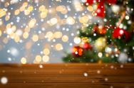 Empty wooden surface over christmas tree lights Stock Photos