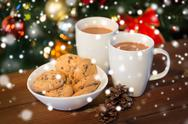 Oat cookies and hot chocolate over christmas tree Stock Photos