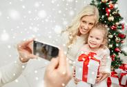 Family taking picture with smartphone at christmas Stock Photos