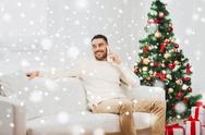Man calling on smartphone at home for christmas Stock Photos