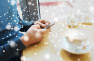 Close up of man with smartphones at cafe Stock Photos