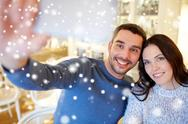 Couple taking smartphone selfie at cafe restaurant Stock Photos