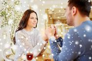 Happy couple with tea holding hands at restaurant Stock Photos