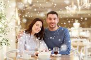 Happy couple drinking tea at restaurant Stock Photos