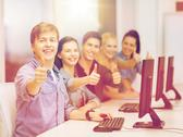 Students with computer monitor showing thumbs up Stock Photos