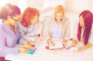 Team with color samples and blueprint at office Stock Photos