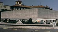 Udine, Italy 1970s: traffic in front of Tempio ossario dei Caduti d'Italia Stock Footage
