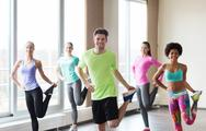 Group of smiling people exercising in gym Stock Photos