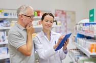 Pharmacist with tablet pc and senior man Stock Photos