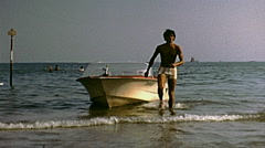 Jesolo, Italy 1978: man leaving the motorboat Stock Footage