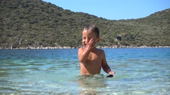 Child gulps with sea water and coughs Stock Footage