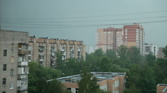 Heavy rain with thunderstorm in the city. Sometimes a flash of lightning Stock Footage