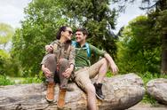 Smiling couple with backpacks in nature Stock Photos