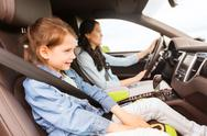 Happy woman with little child driving in car Stock Photos