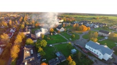 Burning house. Autumn city landscape. Smoke and fire. Aerial footage. Stock Footage