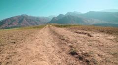 Girl in sportswear Jogging in a mountainous area in slow motion Stock Footage