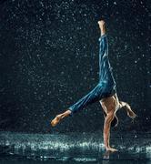The male break dancer in water Stock Photos