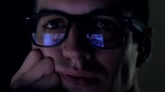 Man watching nude content on internet reflection on glasses Stock Footage
