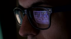 Man watching porno content on internet reflection on glasses Stock Footage
