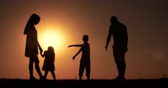 4k silhouette family father mother two children, playing in the background of Stock Footage