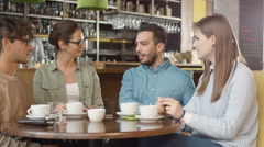 Group of  Positive Mixed race Young People Having Conversation in Coffee Shop. Stock Footage