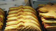 Taiyaki, Japanese traditional dessert. Pancake in fish shape fill with red bean Stock Footage