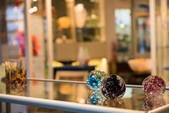 Handmade blown glassware on display Stock Photos