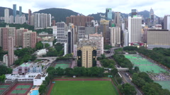 Elevated view, Victoria park and Central district of Hong Kong Island Stock Footage