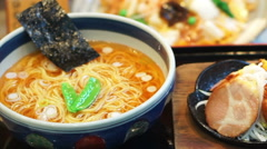 Spicy Japanese ramen noodles with spicy soup, pork and seaweed Stock Footage