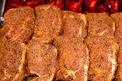 Marinade meat at display counter Stock Photos